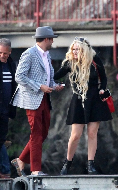 avril lavigne packs on some pda with beau phillip sarofim