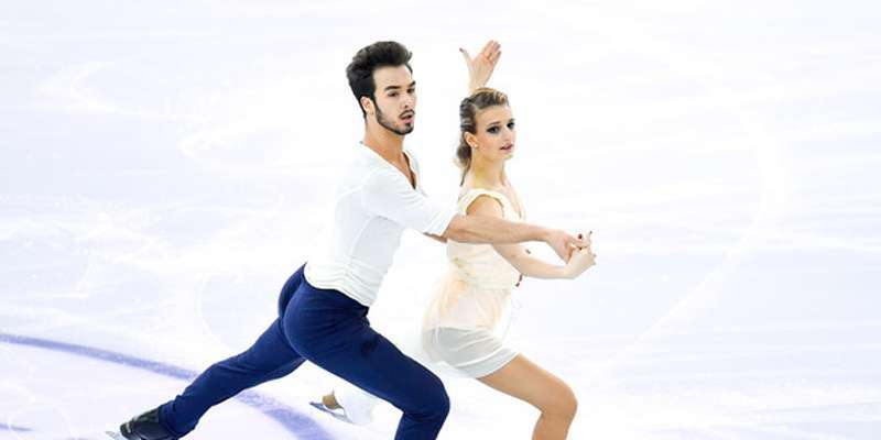 Guillaume Cizero becomes first in the short dance at the 2016 World Championships in Boston