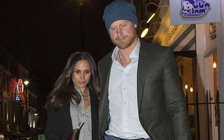 Prince Harry photographed holding his girlfriend Meghan Markle hand in London busy street