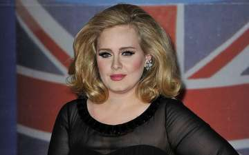 Simon Christopher and his girlfriend British pop singer Adele