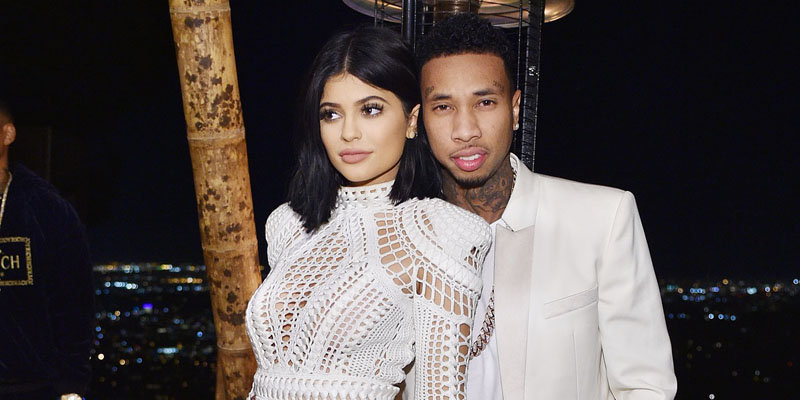 Kylie Jenner and Tyga share a kiss in a photo booth as they get their relationship going once again