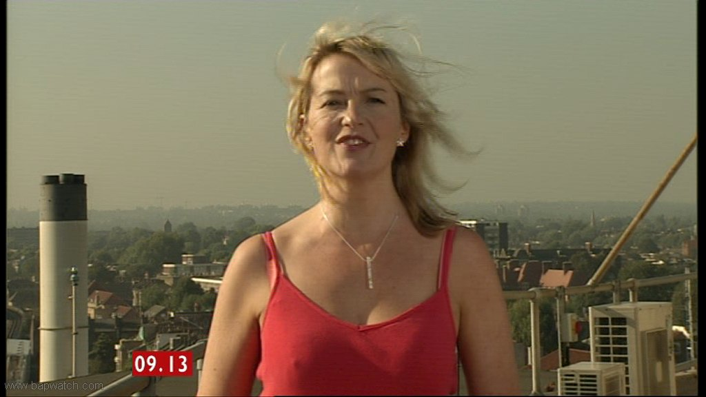 Carol Kirkwood diverts viewers when she appeared in sensational red dress