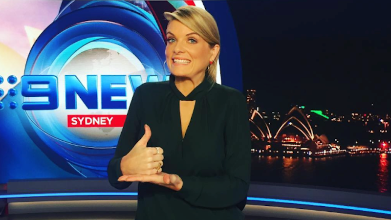 Games moderator Erin Molan tumbles off her seat amid Nine News bulletin