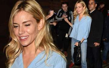 Sienna Miller signs an autograph after Cat On A Hot Tin Roof performance