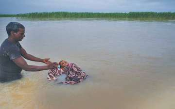 No Place To Set A Funeral Pyre, Parent Bound To Abandon A Dead Child In The Flood In Terai