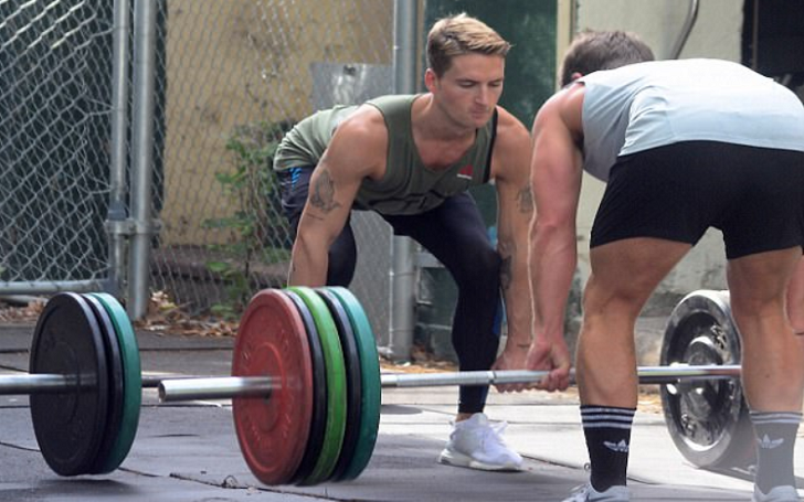 Made In Chelsea's Oliver Proudlock Shows Off His Muscles as He Lifts Weights