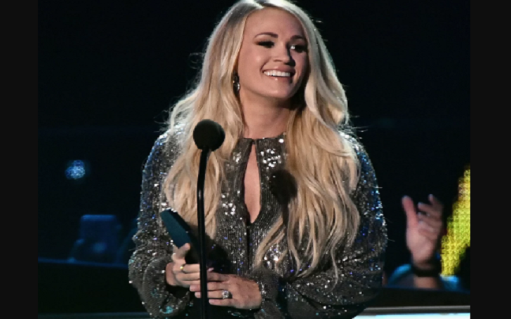 Carrie Underwood Makes History Again: Kisses Husband Mike Fisher After Winning CMT Award for Female Video of the Year