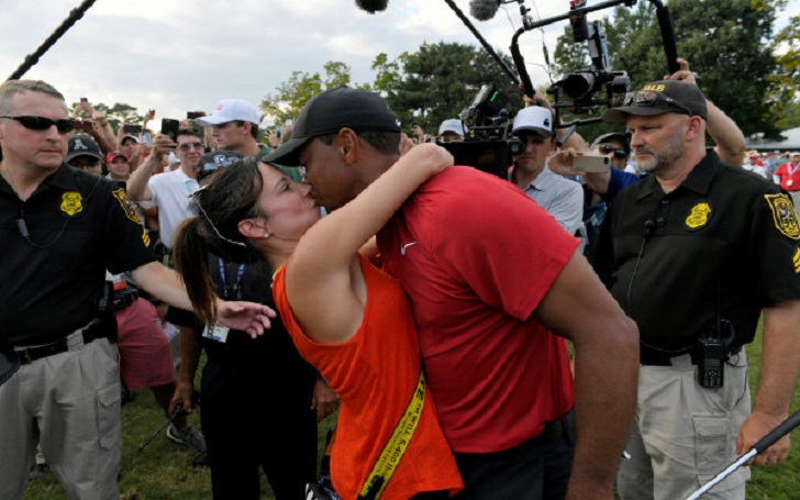 tiger woods wins first golf tournament in five years  gets a kiss from girlfriend erica herman