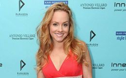 Kelly Stables could not hold her laugh as her son tries salt and vinegar chips for the first time