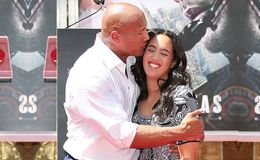 Dwayne Johnson kisses his Partner Lauren Hashian on The Oscars Red Carpet